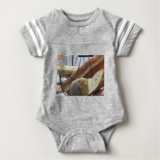 Composition with different types of baked bread baby bodysuit