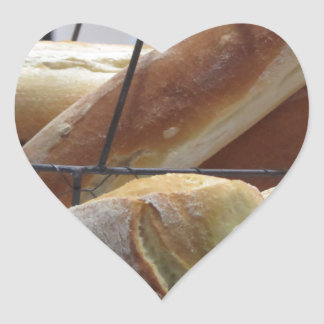 Composition with different types of baked bread heart sticker