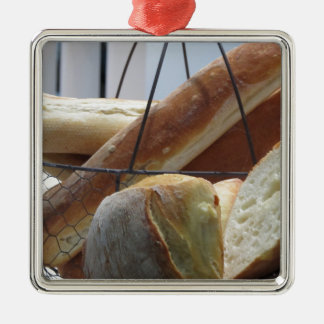 Composition with different types of baked bread metal ornament