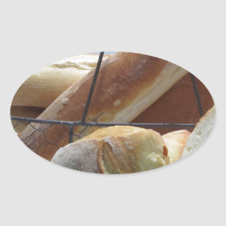 Composition with different types of baked bread oval sticker