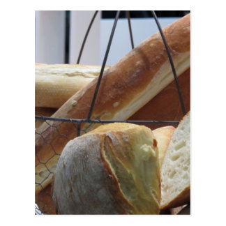Composition with different types of baked bread postcard