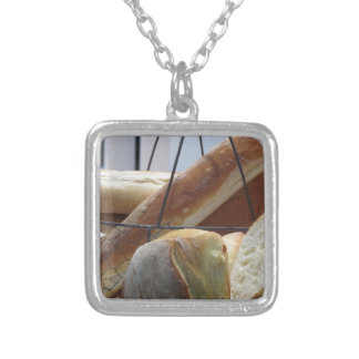 Composition with different types of baked bread silver plated necklace