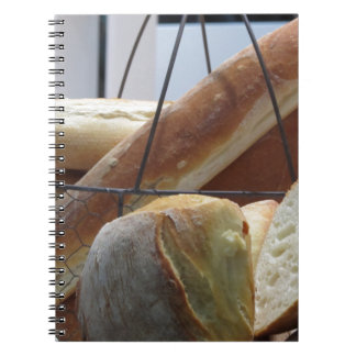 Composition with different types of baked bread spiral notebook