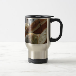 Composition with different types of baked bread travel mug