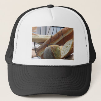 Composition with different types of baked bread trucker hat
