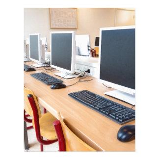 Computers in classroom on high school letterhead