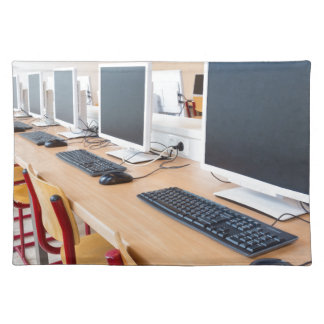 Computers in classroom on high school placemat