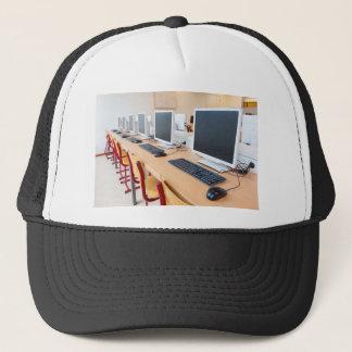 Computers in classroom on high school trucker hat