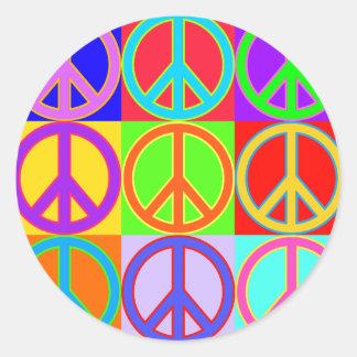 Conception colorée de signe de paix adhésifs ronds