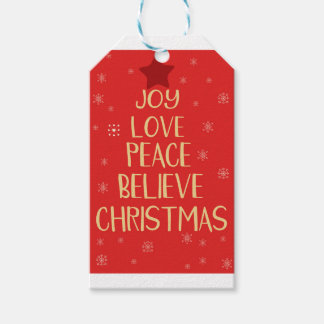 Conceptual christmas tree from words. Red backgrou Gift Tags