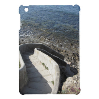 Concrete staircase down to the sea . Spiral stairs iPad Mini Covers