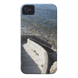 Concrete staircase down to the sea . Spiral stairs iPhone 4 Case-Mate Case