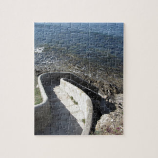 Concrete staircase down to the sea . Spiral stairs Jigsaw Puzzle