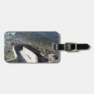 Concrete staircase down to the sea . Spiral stairs Luggage Tag