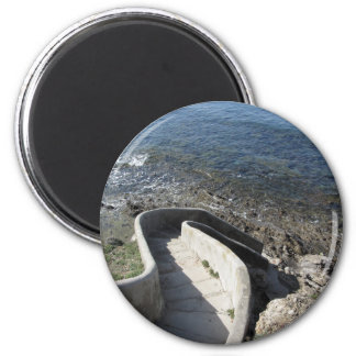 Concrete staircase down to the sea . Spiral stairs Magnet