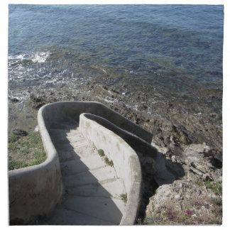 Concrete staircase down to the sea . Spiral stairs Napkin