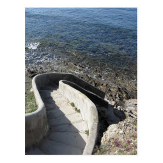 Concrete staircase down to the sea . Spiral stairs Postcard