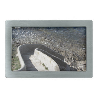 Concrete staircase down to the sea . Spiral stairs Rectangular Belt Buckle