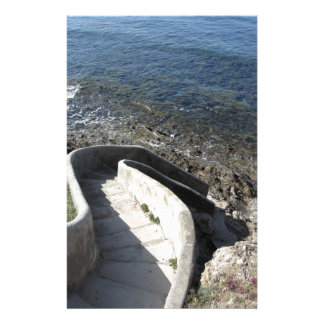 Concrete staircase down to the sea . Spiral stairs Stationery