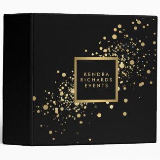 Confettis d'or de Faux sur le classeur noir