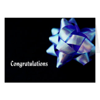 Congratulations with blue ribbon against black card