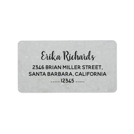 contact address with handwritten name on pale grey label