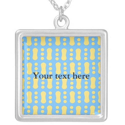 Contemporary yellow peanut pattern on blue jewelry