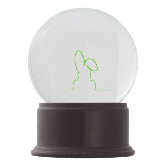Contour of a hare light green snow globe