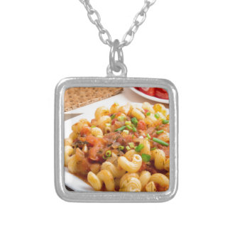 Cooked pasta cavatappi closeup silver plated necklace