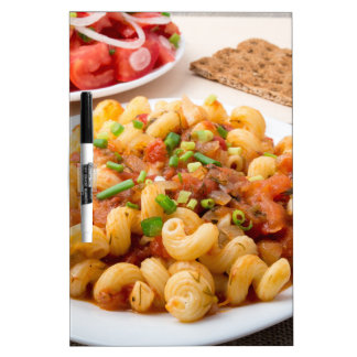 Cooked pasta cavatappi with stewed vegetable sauce dry erase board