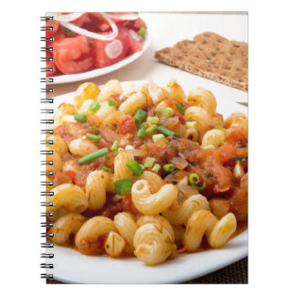 Cooked pasta cavatappi with stewed vegetable sauce notebooks