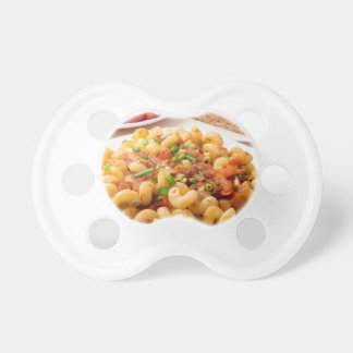 Cooked pasta cavatappi with stewed vegetable sauce pacifier