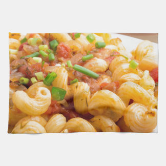 Cooked pasta cavatappi with vegetables sauce towel