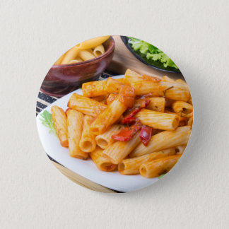 Cooked rigatoni pasta, seasoned with pepper 2 inch round button