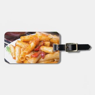 Cooked rigatoni pasta, seasoned with pepper bag tag