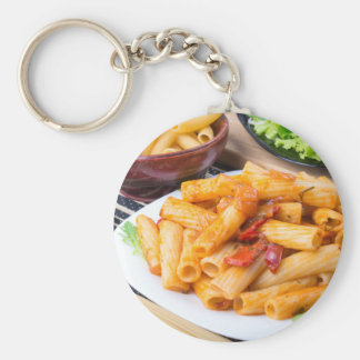 Cooked rigatoni pasta, seasoned with pepper basic round button keychain