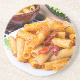 Cooked rigatoni pasta, seasoned with pepper coaster