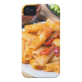 Cooked rigatoni pasta, seasoned with pepper iPhone 4 case