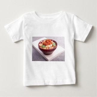 Cooked spaghetti in a brown small wooden bowl baby T-Shirt