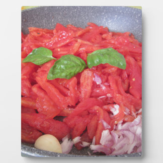 Cooking homemade tomato sauce plaque