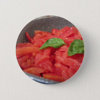 Cooking homemade tomato sauce using fresh summer t 2 inch round button