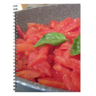 Cooking homemade tomato sauce using fresh summer t notebooks