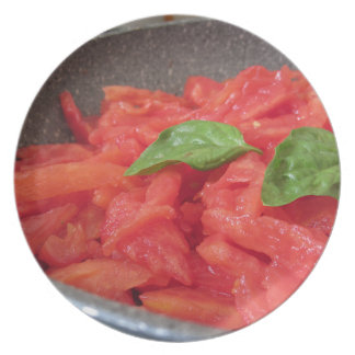 Cooking homemade tomato sauce using fresh summer t plate