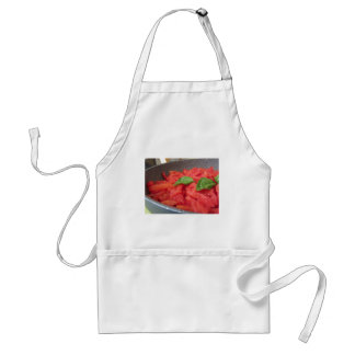 Cooking homemade tomato sauce using fresh summer t standard apron
