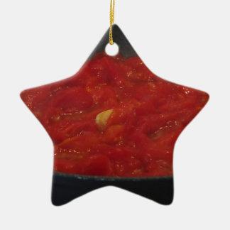 Cooking homemade tomato sauce using fresh tomatoes ceramic ornament