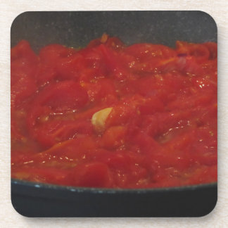 Cooking homemade tomato sauce using fresh tomatoes coaster