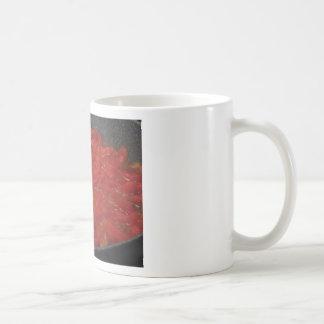 Cooking homemade tomato sauce using fresh tomatoes coffee mug