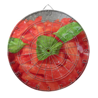 Cooking homemade tomato sauce using fresh tomatoes dartboard