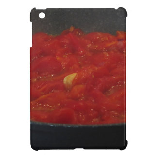 Cooking homemade tomato sauce using fresh tomatoes iPad mini cases