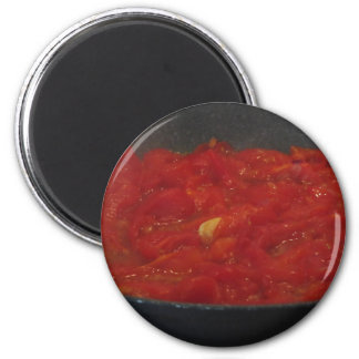 Cooking homemade tomato sauce using fresh tomatoes magnet